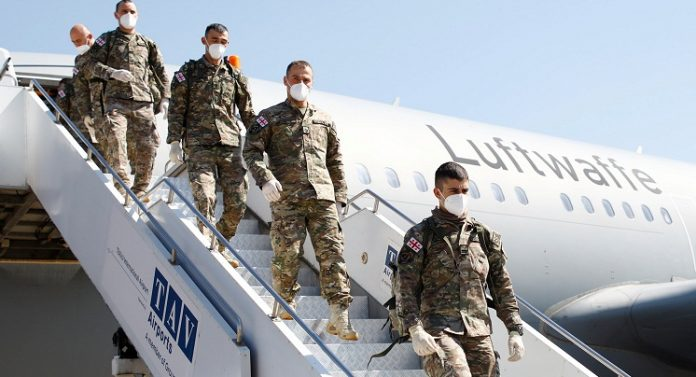 Georgian soldiers leaving Afghanistan along with NATO, US forces
